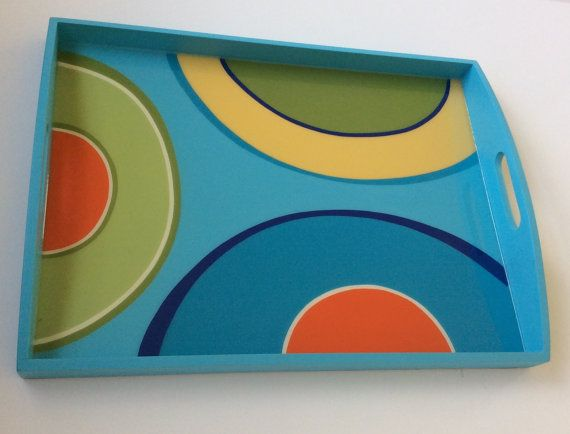 Handmade, painted, tray with special modern design. After the Tray is hand painted, it is coated with a clear resin layer to seal and protect the painting. Each piece is original and created in our studio . Colors may vary slightly due to computer differences. Wipe clean with a damp cloth. Do not put in dishwasher or immerse in water. Please let me know if you have any questions and Ill be happy to help. Tray arrives wrapped in bubble wrap for secure shipping, and a beautiful bag with a hand…