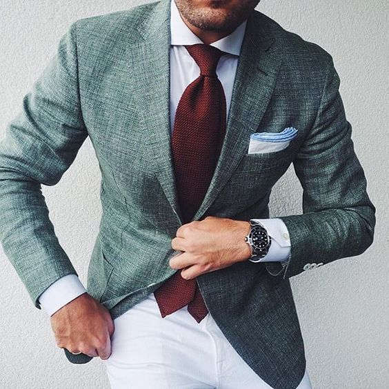 Reach for a dark green suit jacket and white chinos to look classy but not particularly formal.   Shop this look on Lookastic: https://lookastic.com/men/looks/blazer-dress-shirt-chinos/20881   — White Dress Shirt  — Burgundy Tie  — White Pocket Square  — Dark Green Blazer  — Silver Watch  — White Chinos