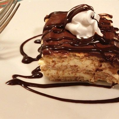 """Chocolate Eclair Dessert I """"Delicious! We also made it with different flavors of pudding and frosting. Banana cream pudding and strawberry frosting was my family's favorite."""""""