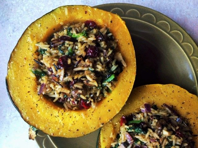 This herbed stuffed acorn squash will make it feel like Thanksgiving any night. It's fragrant, savory and sweet with cranberries. GF vegan. By Lauren Sacerdote
