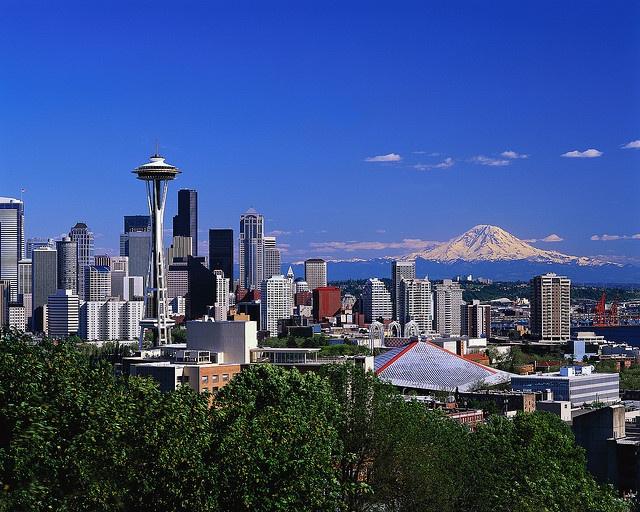 Seattle and Mt. Rainier.  My hometown but 20 miles north (Richmond Beach).