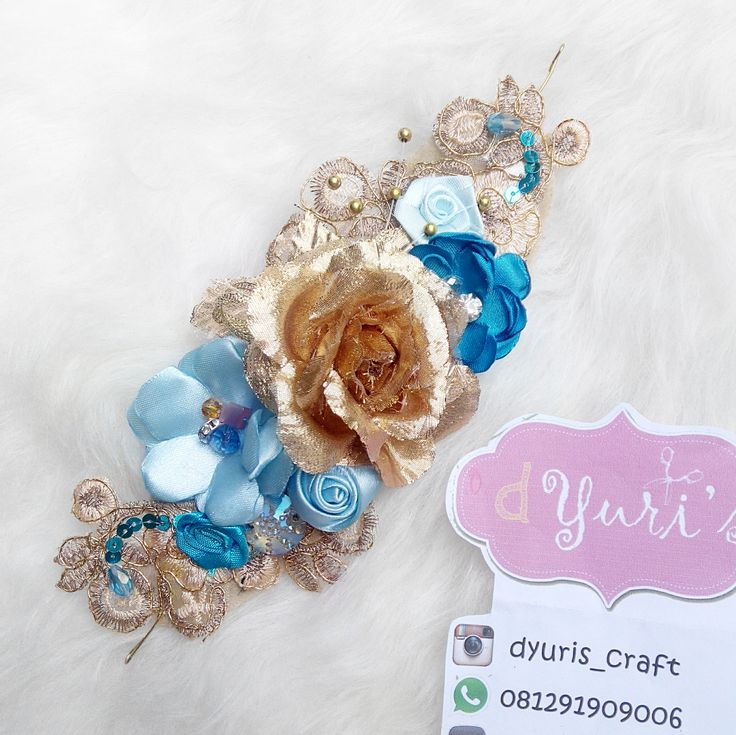 blue and gold long brooch, its also a crown
