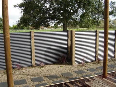 Corrugated metal fence with simple wood posts.                                                                                                                                                                                 More