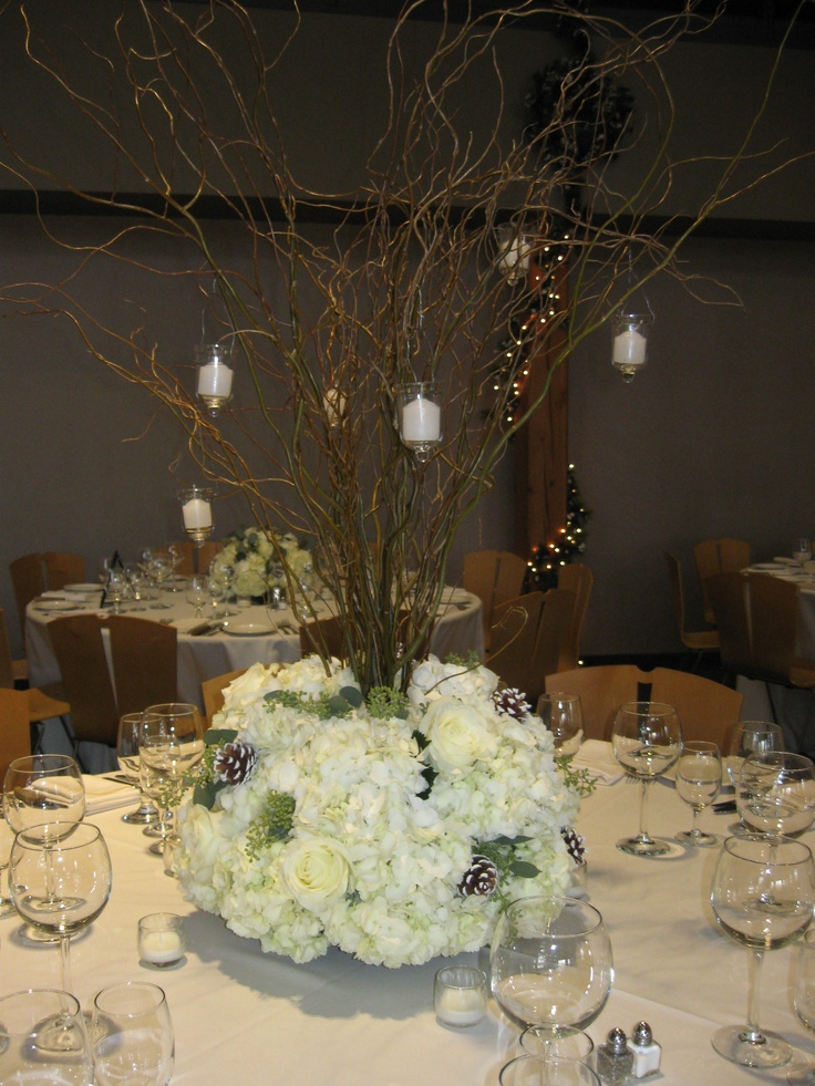 Gorgeous Tall Winter Wedding Centerpieces With White Hydrangea White Roses Frosted Pinecones