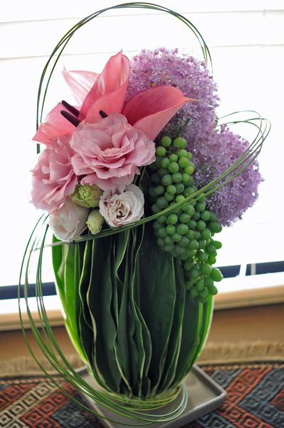 flower arrangement, Allium giganteum, Anthurium, Eustoma, Dracaena, Grape, Steel grass Corporate flowers, corporate flower centerpiece, add pic source on comment and we will update it. www.myfloweraffair.com can create this beautiful flower look.