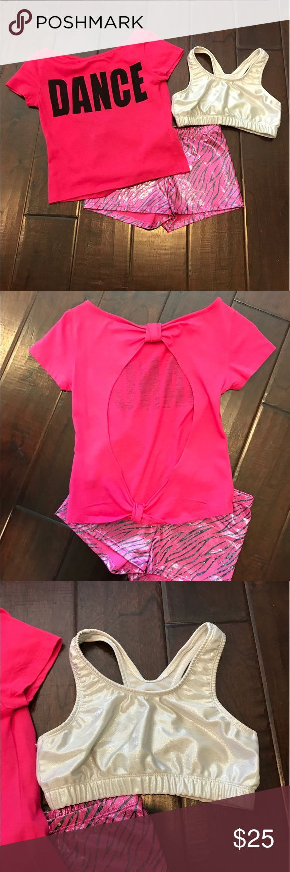 """Girl's DANCE bundle size L 3 pc girl's dance bundle. Silver sports bra and """"Dance"""" top Size youth large. Tumble shorts size 12-14. Can break the bundle if requested. All in excellent condition. Body Wrappers Costumes Dance"""