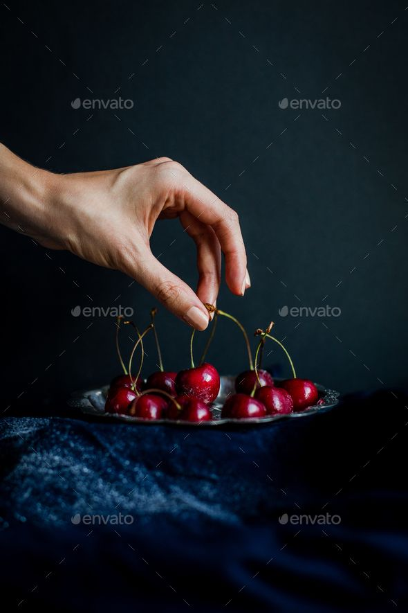 Hand Picking Red Cherries from Silver Platter against Black Background - Stock Photo - Images Download here : https://photodune.net/item/hand-picking-red-cherries-from-silver-platter-against-black-background/18917606?s_rank=3&ref=Al-fatih