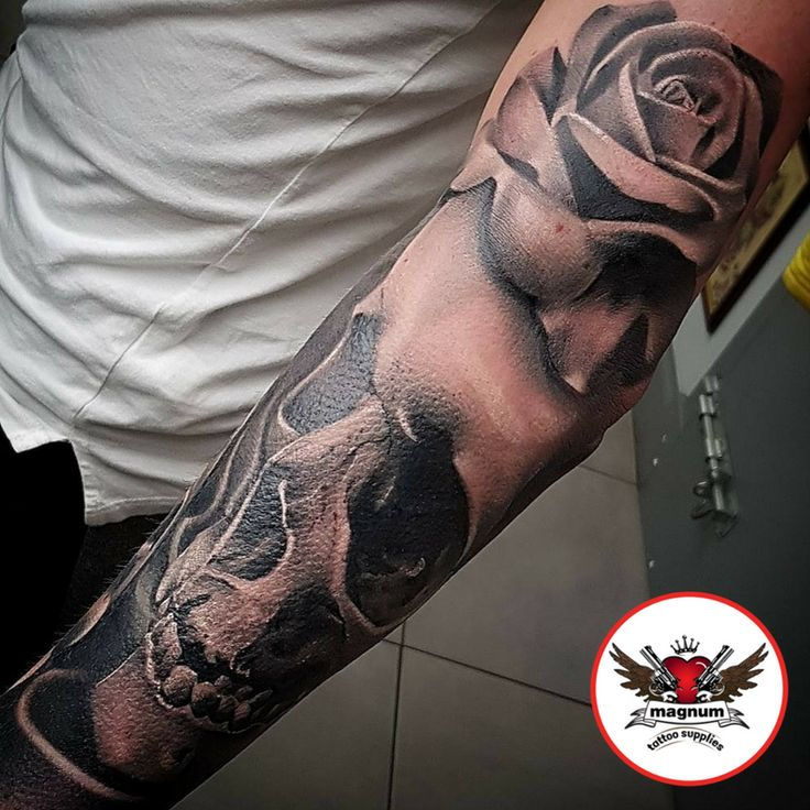 Black and grey skull and rose piece done by Mikkel Østberg, Mint Gun Club Tattoo Parlour  using #magnumtattoosupplies