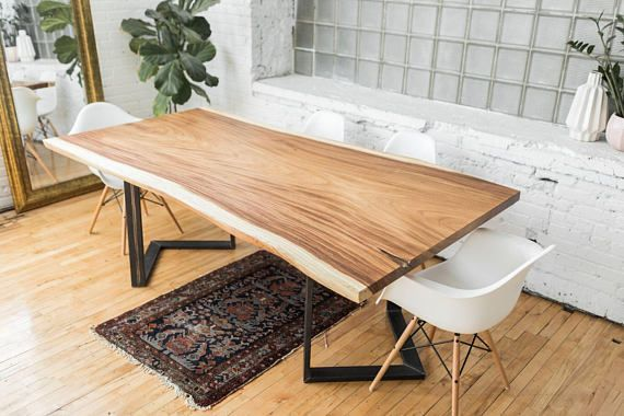 """Natural edge Slab of Costa Rica grown Guanacaste mounted on industrial steel base. Hand finished with premium varnish. Slab pictured: 89"""" x 38-45"""" x 30"""". This slab is currently available. We happily customize table dimensions, wood species and leg type. Prices start at length of 60""""."""