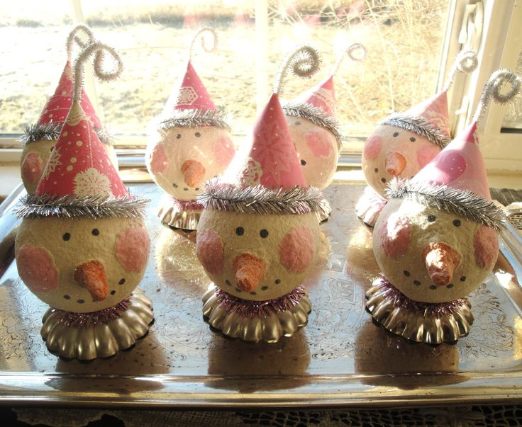 My 1st try at paper mache. Little snowgirls sitting on tart tins.