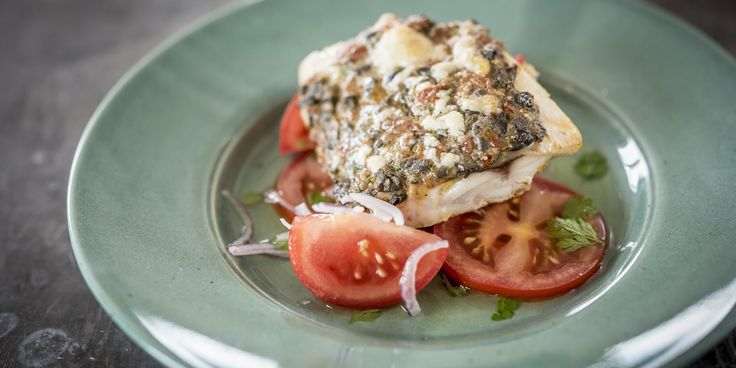 A delicious, quick and simple baked hake recipe from Nathan Outlaw, with a Mediterranean crust of cheddar, olives and sun-dried tomatoes.