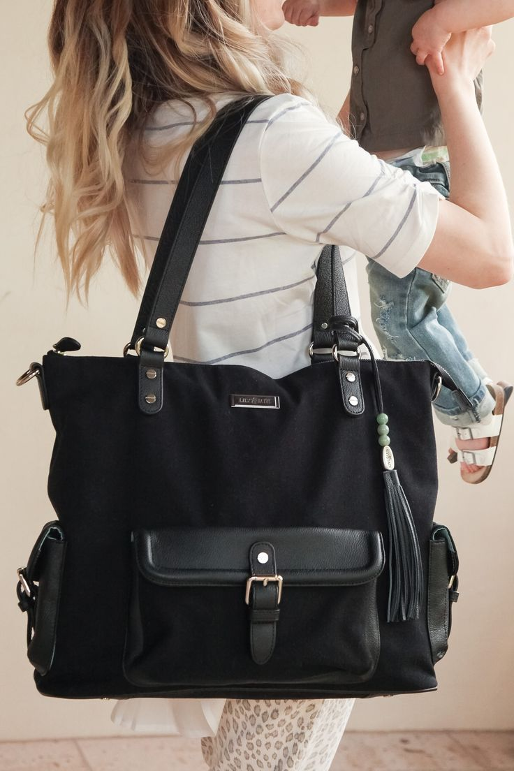 "Ever shy away from purchasing a diaper bag because you were afraid it would make you look too ""mom-ish""--and then struggle with all your baby gear getting all jumbled together and bottles spilling everywhere? Enter: Lily Jade diaper bags! They are classic, luxury diaper bags that can be worn 3 ways (including BACKPACK!)...and have over 16 POCKETS to keep all your baby things exactly how you want them. Also? They just make you look GOOD! Click to purchase the Meggan in black canvas!"