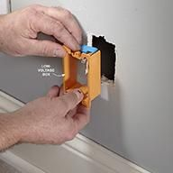 Install a Low-Voltage Box for Coaxial Cable - Tips for Coaxial Cable Wiring: http://www.familyhandyman.com/electrical/wiring/tips-for-coaxial-cable-wiring#9