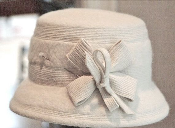 Hey, I found this really awesome Etsy listing at https://www.etsy.com/listing/227427308/creamy-white-vintage-wool-felt-hat-with
