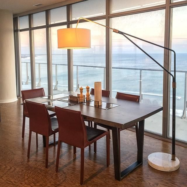 An Arc Lamp Illuminates The Dining Table