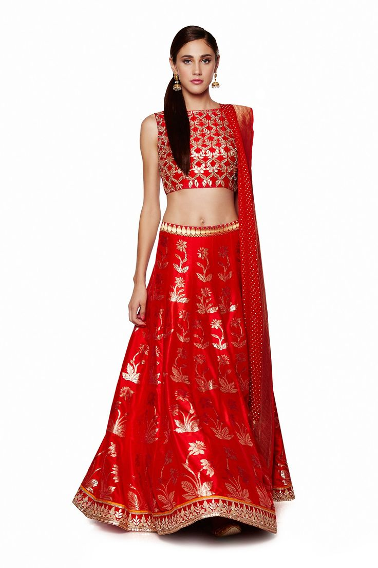 Featuring a flaming scarlet lehenga with exquisitely rich Banaras hand-woven work. Team this lehenga, choli and dupatta with gold earrings for an extravagantly gorgeous look. Rs.192,000.00