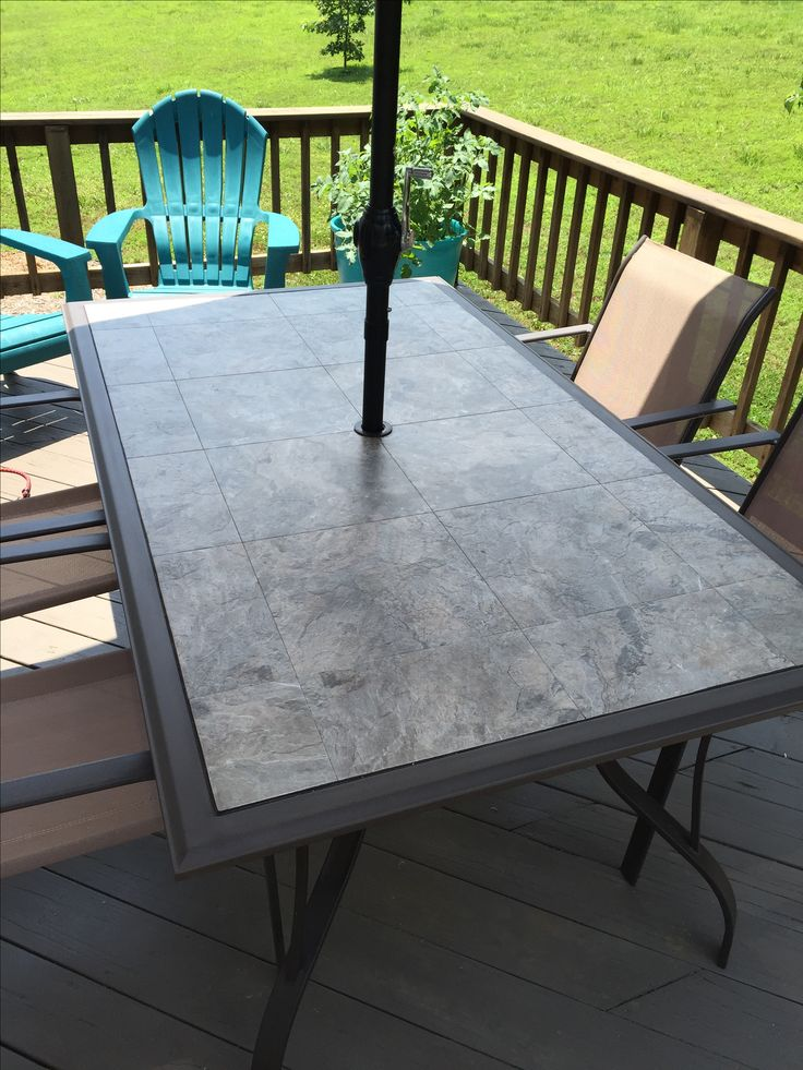 The glass table top shattered in 1,000 pieces when the breeze caught the umbrella!  Replaced it with a plywood top and Armstrong  self-stick vinyl tile.  Routed the outside edges.  Caulked the crack between the top and frame with brown stretch silicone caulk.  Wonder how long it will hold up on the west side of our house?  Looks good for now!!