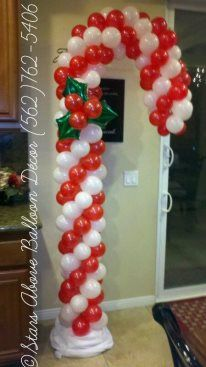Christmas candy cake balloon sculpture... I can see these on both side of an entry to a holiday party or event.