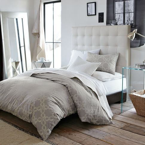 grid-tufted headboard. i'd want it upholstered in fabric though, not leather.