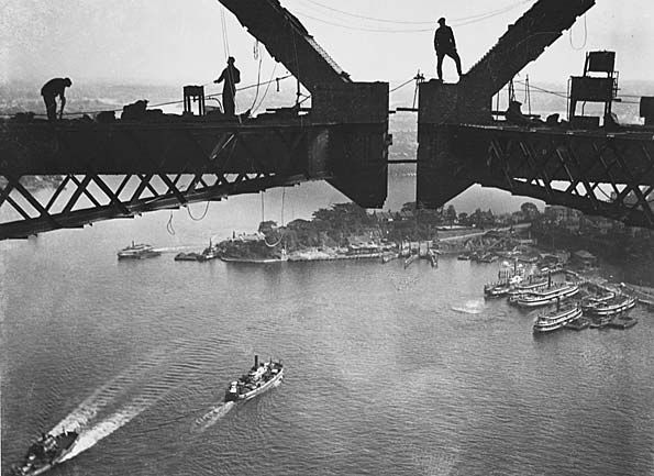 The closing of the two halves of the arch of the Sydney Harbour Bridge prior to the deck being added. Taken by Australian photographer Henri Mallard, 1930.