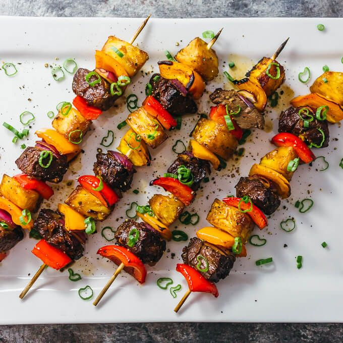 I love these crazy good Hawaiian steak kabobs with pineapples and bell peppers. They're marinated with a Hawaiian steak marinade and broiled in the oven.