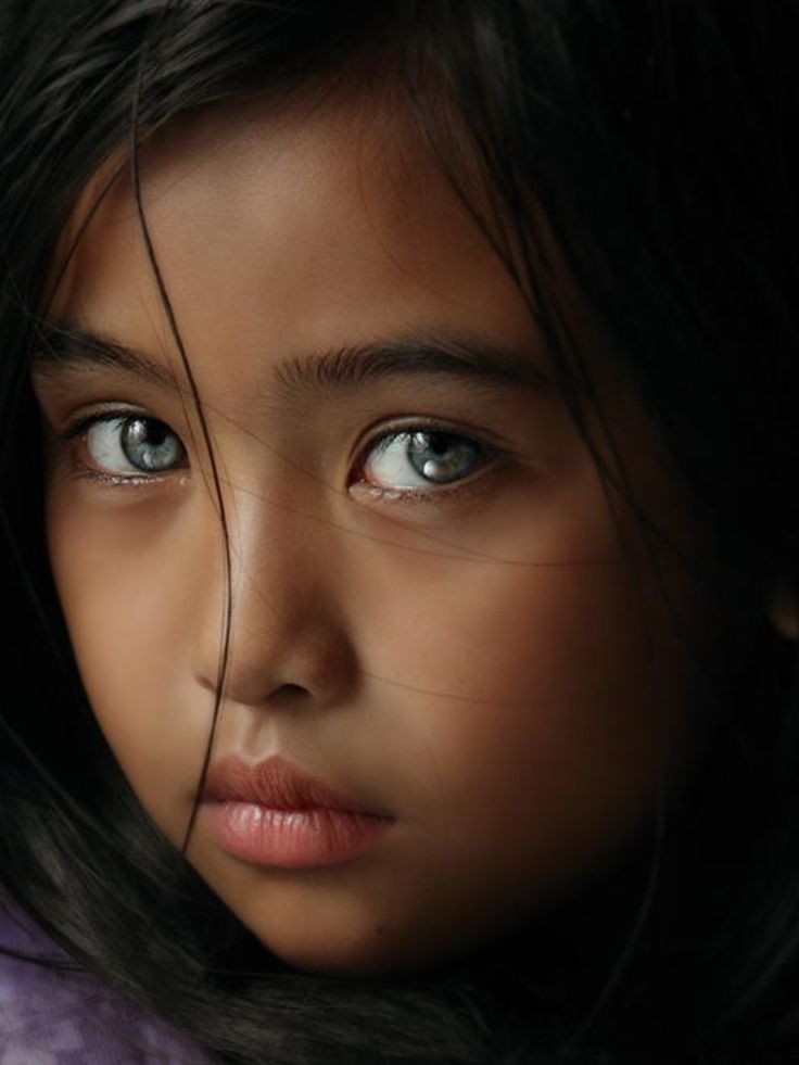 Young girl, Asian with intense light eyes