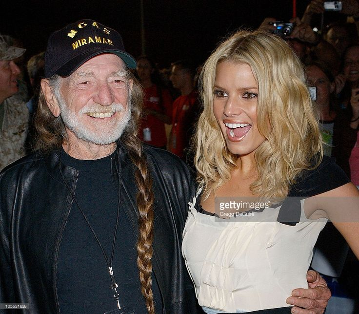 Willie Nelson and Jessica Simpson during 'The Dukes Of Hazzard' Stars Visit Marine Corps Air Station Miramar at Marine Corps Air Station Miramar in San Diego, California, United States.