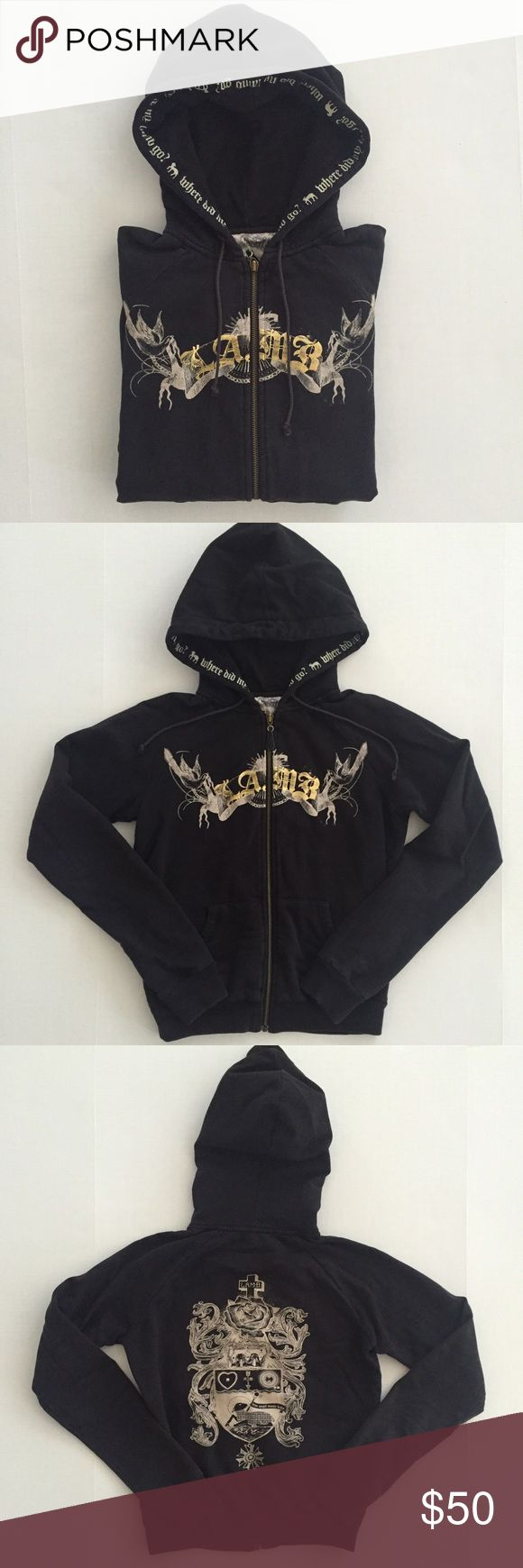 [L.A.M.B] women's zip-up hoodie sweatshirt XS [L.A.M.B] by Gwen Stefani women's zip-up hoodie sweatshirt XS •🆕listing •good pre-owned condition •black with gold/cream logo screen on front and back, intended distressed look •front hand pocket •material 80% cotton 20% polyester, fleece interior •Offers welcomed using the offer feature or bundle/bundle offer for the best discount• L.A.M.B. Tops Sweatshirts & Hoodies