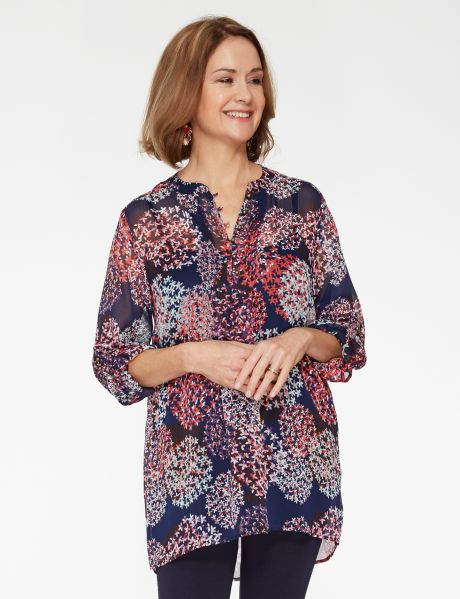 This chiffon all-over print longline top features turn-up long-sleeves and a front button placket.