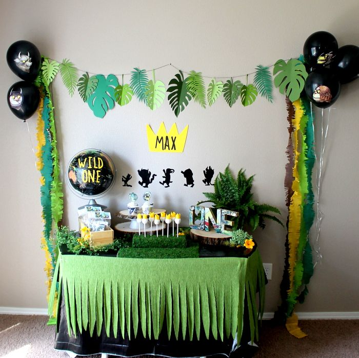 This is a listing for a where the wild things are party decoration Package. Great for birthday parties, baby showers and bedroom decoration! Package Price Deal Includes: Leaf Banner (6 feet long) 8 Mini frilled streamers (7.5 feet long each) 2 in each color; brown, emerald, gold yellow and lime Custom gold yellow max crown Cut out with your childs name Silhouette black sticker decals (great for walls, balloons and windows) Wild thing face decals (5) Table Skirt (8 feet long and 20 inches…