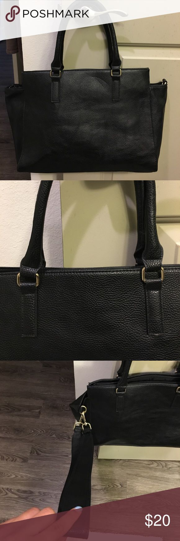 H&M | Black tote bag (with strap) H&M black tote bag that includes a strap to wear as a cross body, I would consider this bag size a medium, more of a travel bag as well yet also dressy. Only has been used once, in perfection condition as well H&M Bags Totes