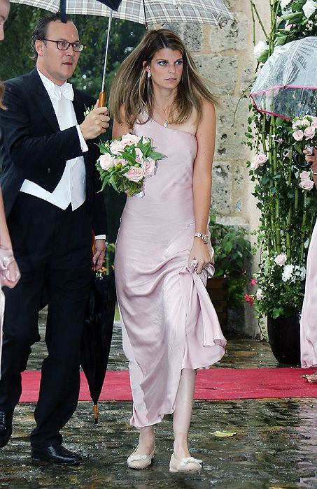 Athina Onassis makes rare public appearance to at half-sister's wedding.