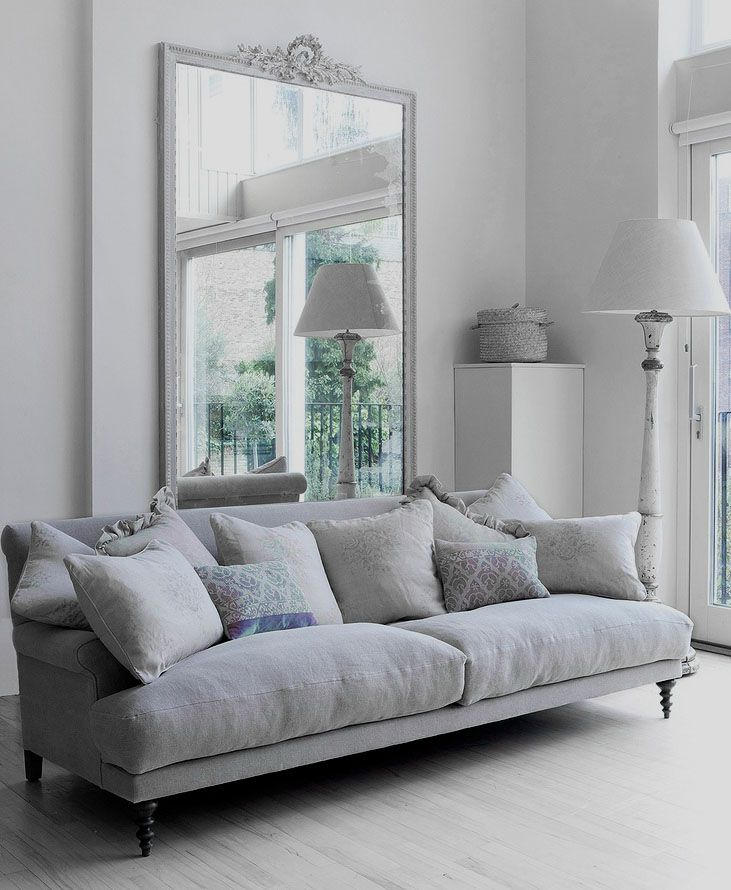 The perfect grey room, delicate patterns on the cushions adds so much interest, just so pretty.