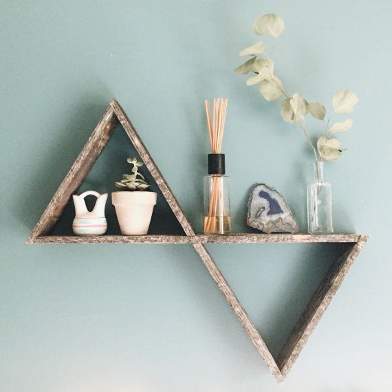 This is a rustic, handcrafted geometric shelf made by my carpenter extraordinaire dad and I! This shelf is totally unique and one of a kind