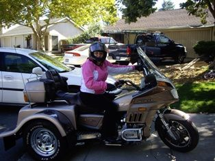 Me with Trike in Sacramento: We bought this last year in February/2008.  My husband learned to ride this year.  I started in May/2009 this year.  I used it to get used to a throttle