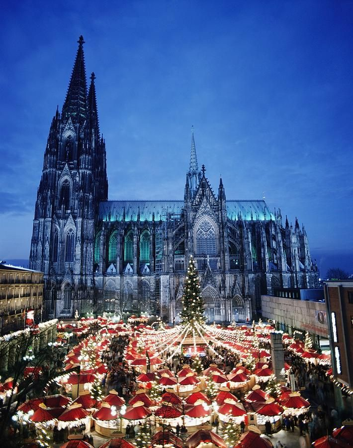 Cologne Cathedral And Christmas Market How lovely, couldn't you just imagine getting all your festive treats here, and how majestic with the brooding cathedral in the background.#christmasaroundtheworld
