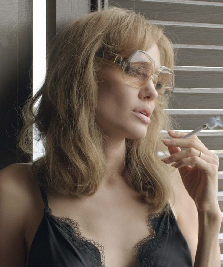 I need sunglasses like these. Angelina Jolie & Brad Pitt Are Sad & Gorgeous In First By The Sea Trailer #refinery29
