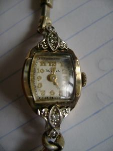 Vintage 1950's Bulova.-this is identical to the watch that my mother wore when I was growing up....possibly, that old thing takes a licking and still keeps on ticking, because I'm fairly certain that she still wears in...hmmm