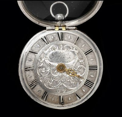 The Jerome Gregory Coach Clock, 1660-70  The  timepiece features a silver case engraved by Hallam with a sea battle during the Anglo-Dutch wars. The movement by Jeremie (or Jerome) Gregory of the Royal Exchange. London, about 1660-70.  Larger than a typical pocket watch, this object would still have fit neatly in a gentleman's pocket, but was also big enough that it could be seen by others riding in a coach should the clock be displayed on a hook or strap.