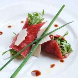 Beef Carpaccio with Dijon and Caper vinaigrette.