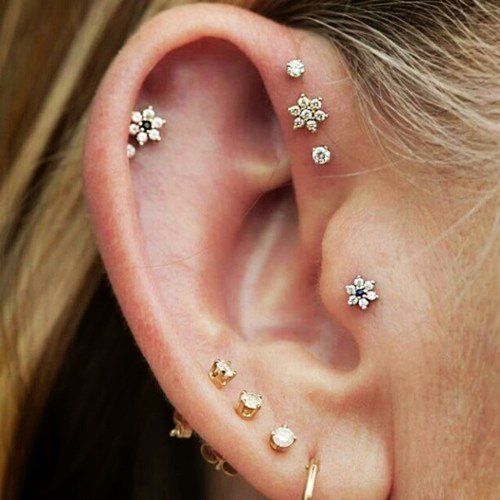 Flower cartilage piercing earrings.. I would never get all of these but a couple are really nice :)