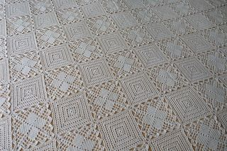 A Bedspread, made of two kinds of patterns.