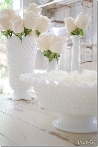White milk glass- I have something just like this, love the idea of white flowers in the glass.