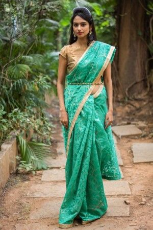 Teal gold jute net saree with gold checked slim...