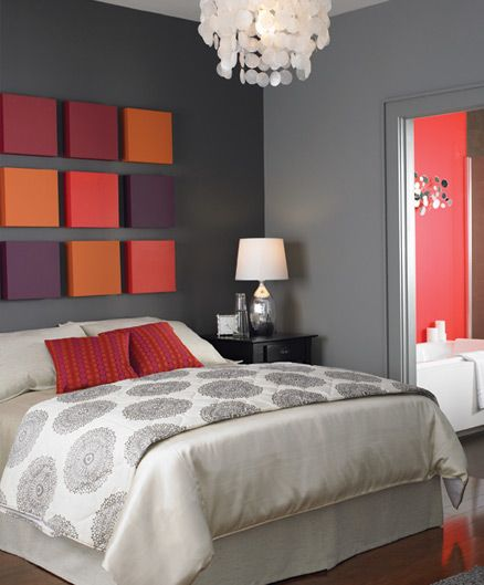 I like the vivid colors in the otherwise colorless room! It's sort of like a headboard and art work at the same time ( good idea but with different colors)