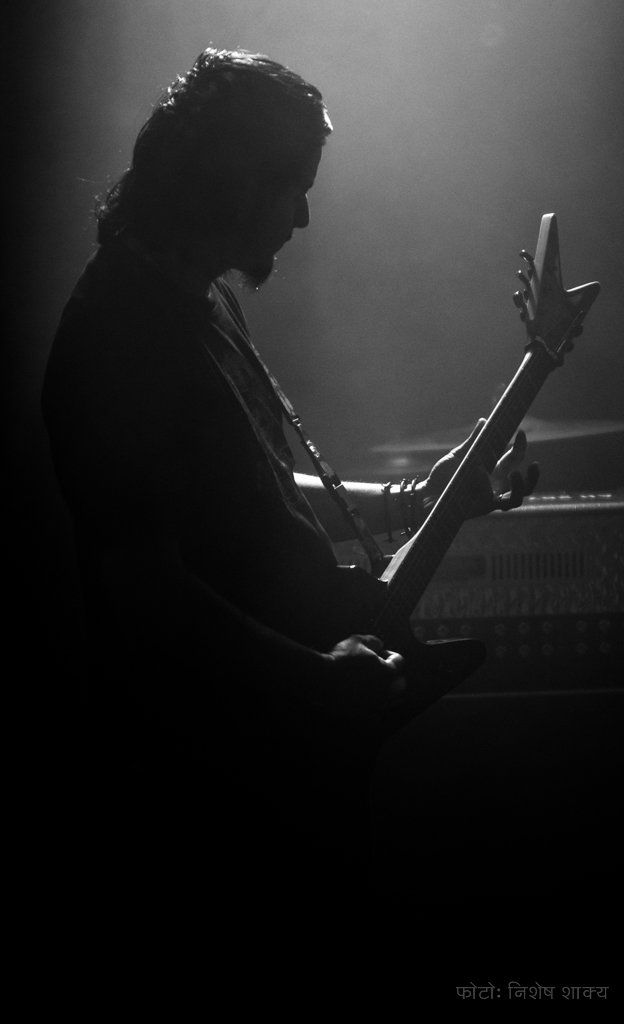 Dipes is a guitarist in a Sydney based Nepali metal band 'Chronic'. He's the main man behind the band and is well known for his mad guitar riffs.This photo was taken at a recent gig called 'Rock Jatra' at Oxford Art Factory in Sydney. The show was organised by Baalai Bhayena Events.