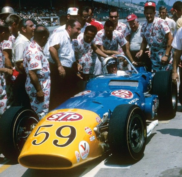 1965, Indy: Jim Hurtubise and Andy Granatelli with the Novi, one of just five front-engine cars that qualified starting 10th on the grid. It exited on the first lap with transmission problems in a race handily won by Jim Clark, the first victory for a rear-engine car at Indy. Side note: Clark ran the entire race on one set of tires.
