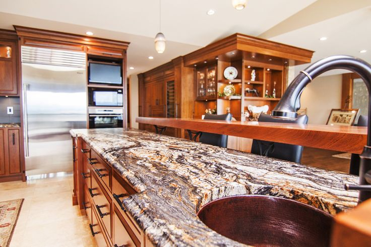 Beautiful Leathered Granite Island with a Floating Raised Bar for Entertaining