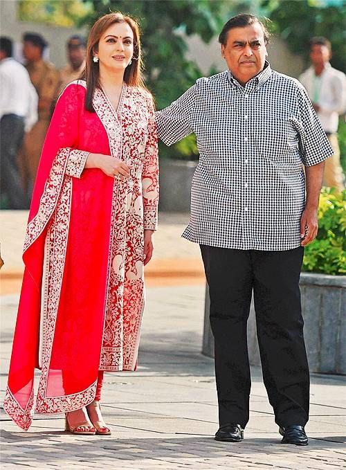 Mukesh and Nita Ambani celebrate the launch of their new venture