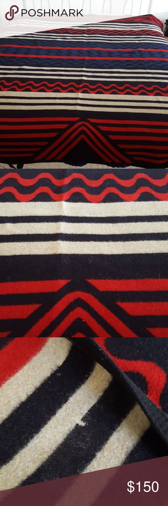 Vintage Pendleton Navajo Blanket Vintage Navajo print Pendleton Blanket. You cannot find this blanket anymore. (Unless you get lucky at a pawn shop in the southwest). Measures 65x 80. Does need a cleaning. Overall in great shape except for noted moth bites see pics. Pendleton Other